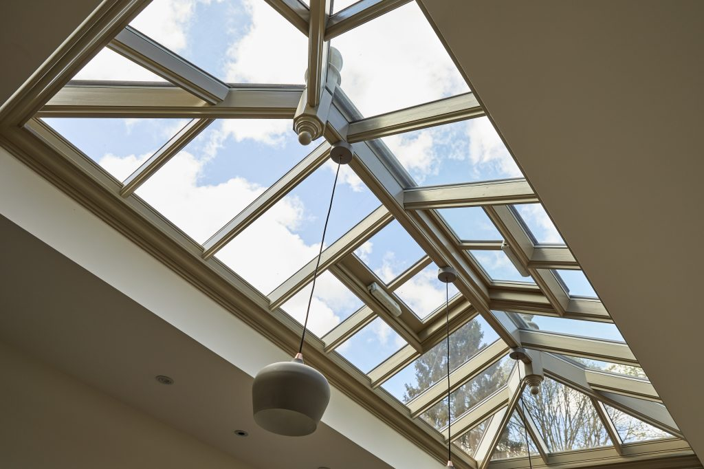 the sky view from beneath a roof lantern